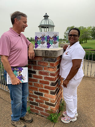 Keith & Peggie with Annual Report.jpg