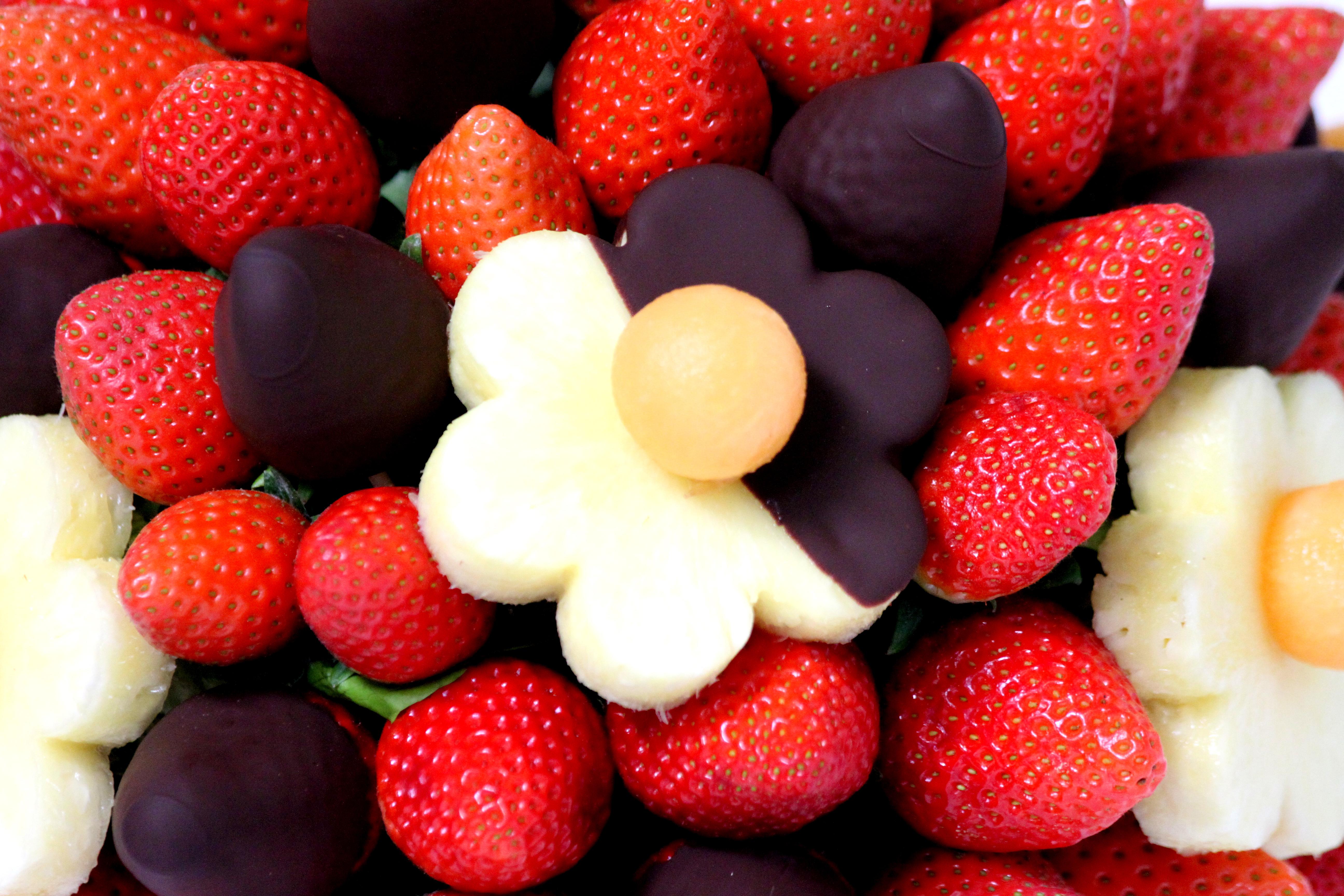 Strawberries and pineapple dippedin dark chocolate