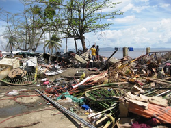 People search through the ruins for anything salvageable..png