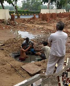 Manhole worker cleaning manhole.jpg