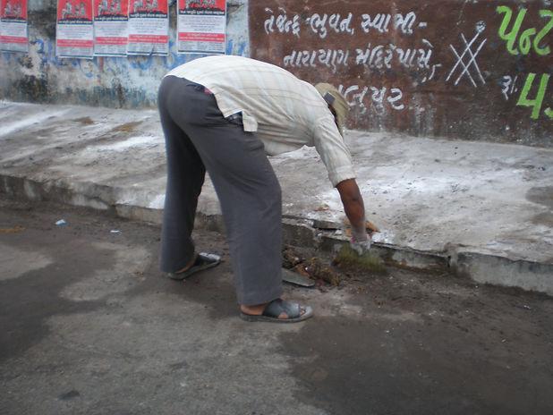 Manual scavenger removing human exctreta
