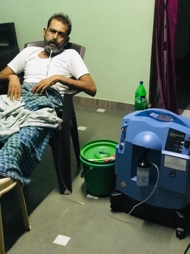 One of the community members using the provided Oxygen concentrators.