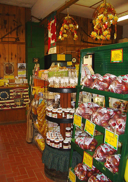 Farm market wall filled with bagged apple varieties & apple butter.