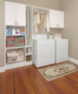 basic laundry room cabints and organizaton in white with bskets and hanging rod with pull out ironingboard