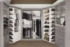 Walk in grey wood clost with 360 organizer to store clothes, shoes shelvs, doors, drawers, & moe