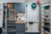 Custom garage storage cabinets ad organization with pull out draers, bench top, wall rack for tools and more storage