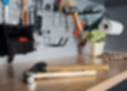 garage organization wall hooks with tool hanging and wood bench top