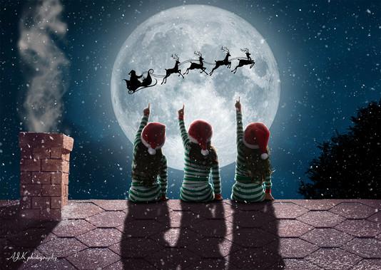 santa in moon roof triplets fb.jpg