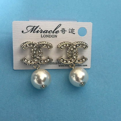 13.  CC Style Gold Rhinestones and White-Pearls.  Silver Pins