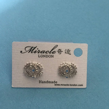 16.  CC Style Silver and Rhinestones with Silver Pins.