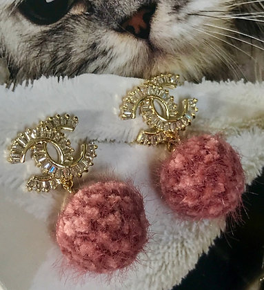 20. CC Style Gold and Rhinestones with pompom.