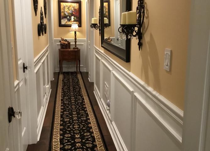 Basement Hallway With Wainscoting