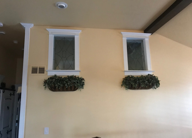 Painted Wall With Interior Windows And Trimwork