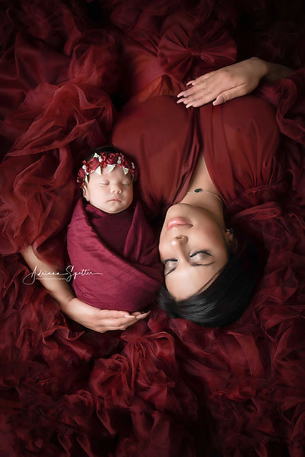 mama with baby in red.jpg