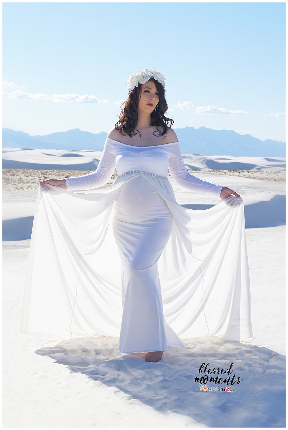 Butterfly pose for maternity shoot at White Sands