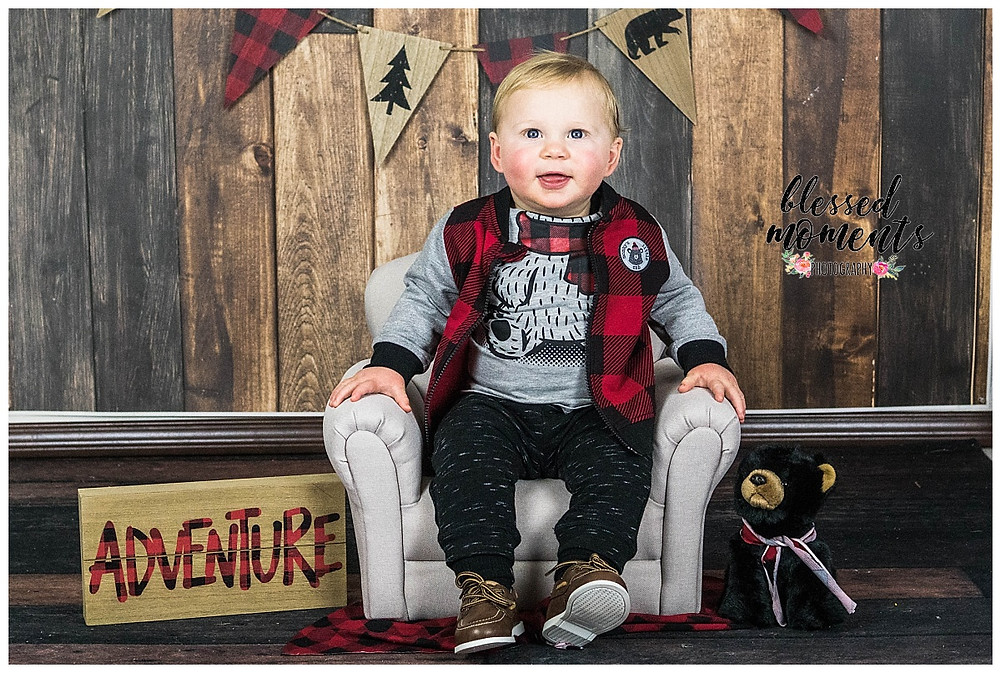 Cabin themed photo shoot for one year old boy