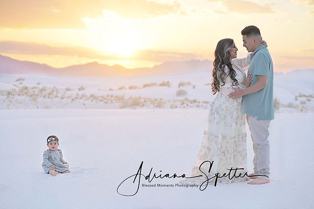 White Sands Family photography with couple embracing in front of setting sun