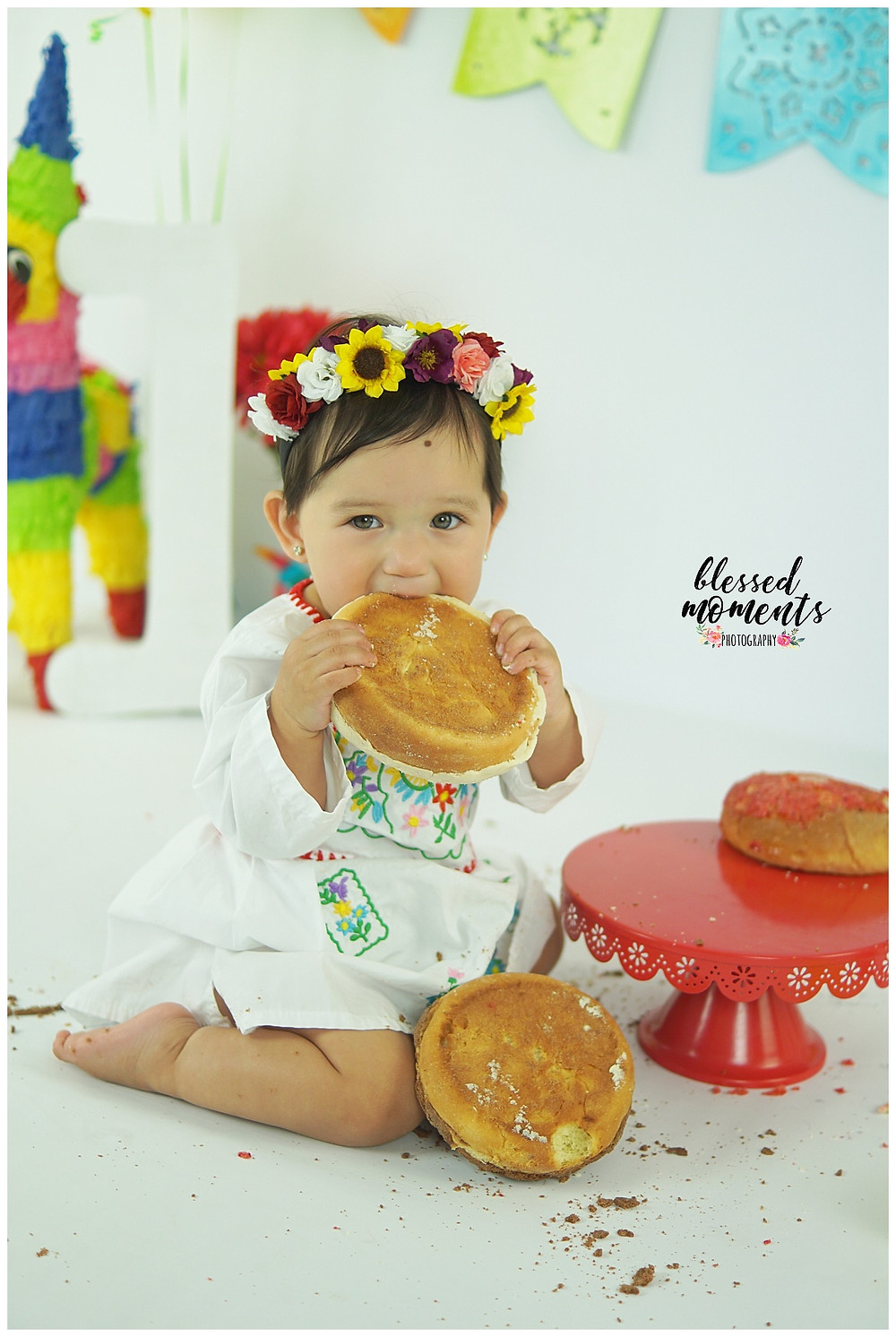 little girl eating pan dulce in photo session.
