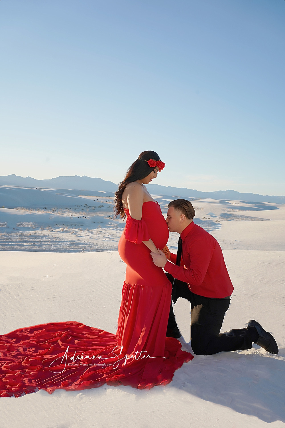 Husband kissing mama's belly at White Sands National Park.