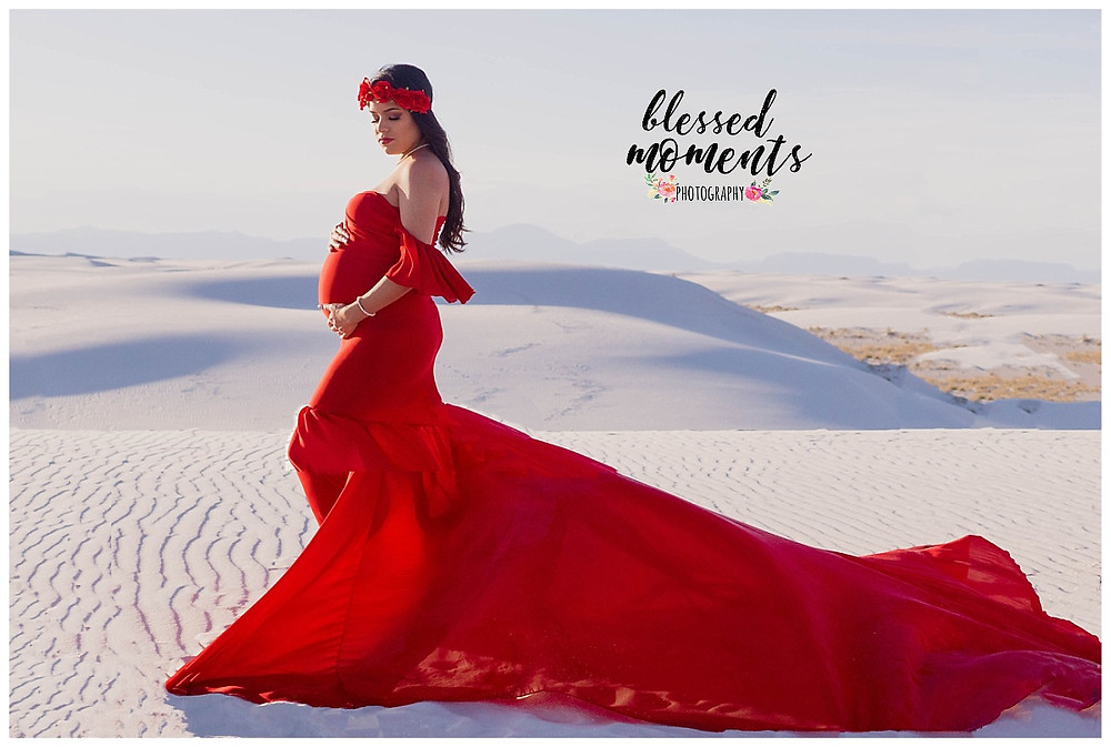 El Paso mama wearing a stunning red dress in White Sands National Monument