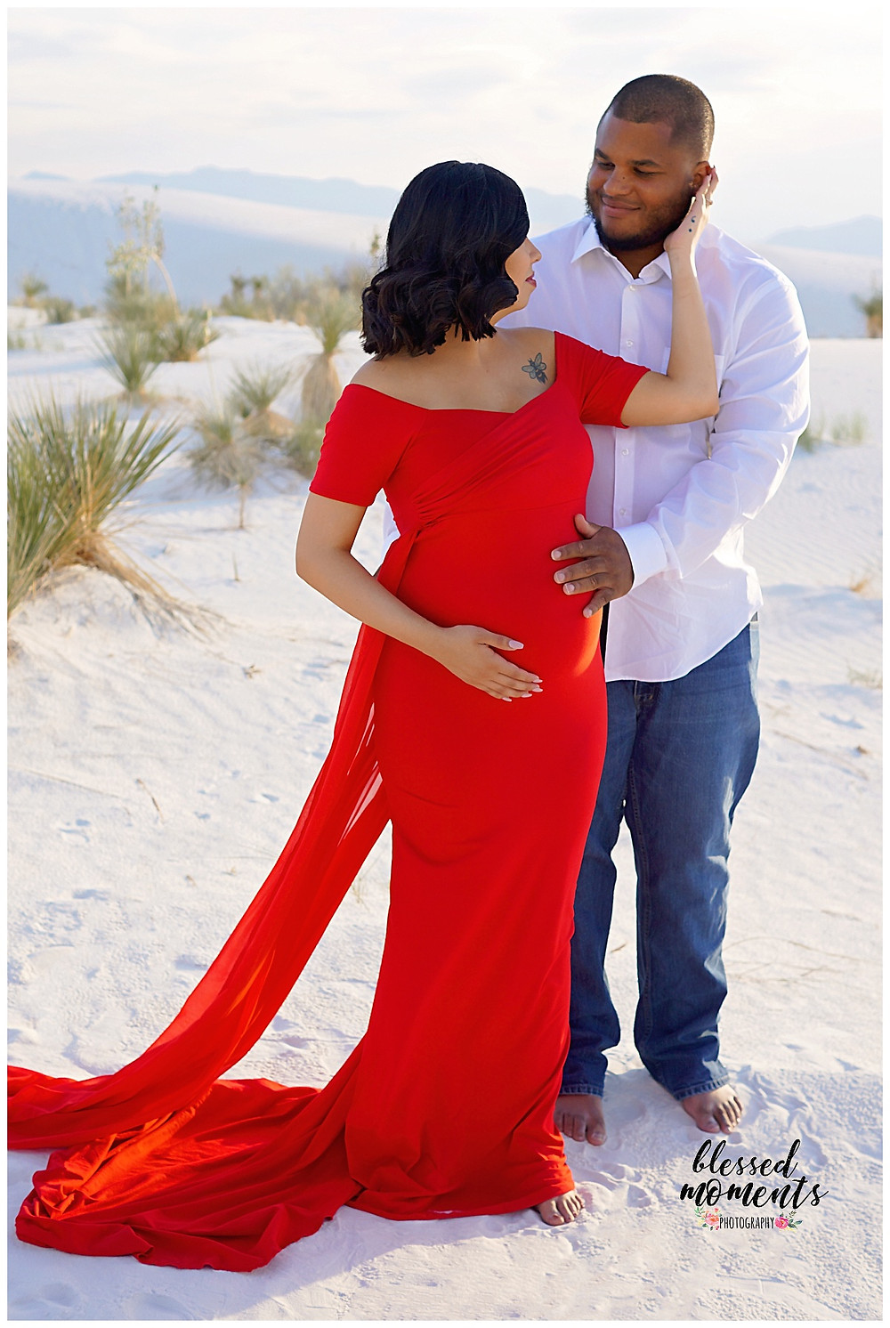 Red Maternity dress and proud papa at white Sands National Monument.
