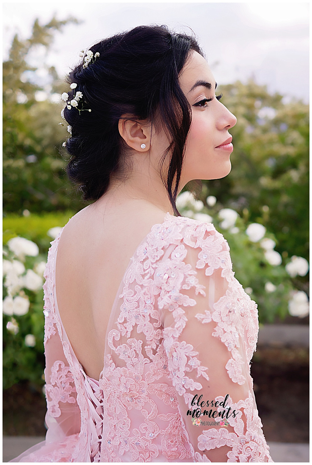15 year old girl in her Quinceanera  dress photo session at El Paso Rose Garden
