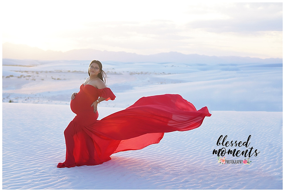 Red flowing maternity gown at White Sands National Monument