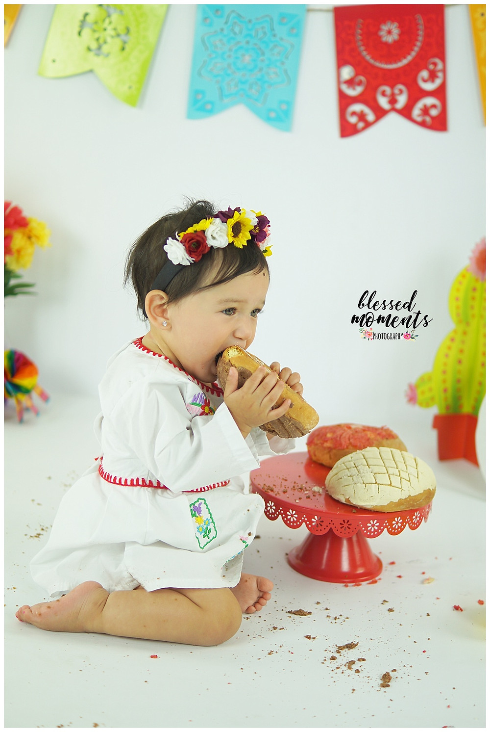 Fiesta photo session with little girl eating pan dulce