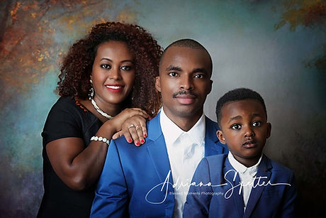 Alamogordo family photographer with family photo done in studio with fall backdrop