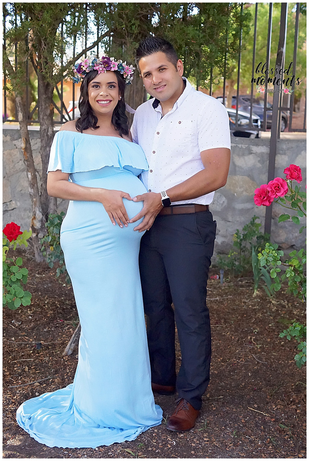 Proud papa and expecting mother maternity photo taken in El Paso Rose Garden