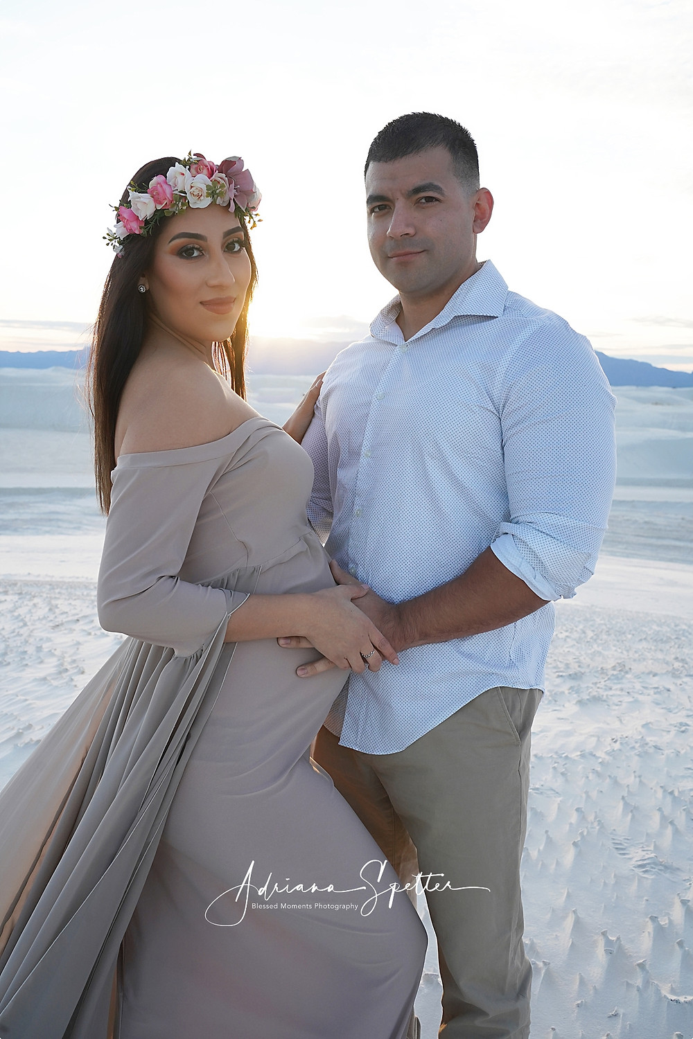 El Paso Couple posing for a maternity shoot at White Sands National Park during sunset