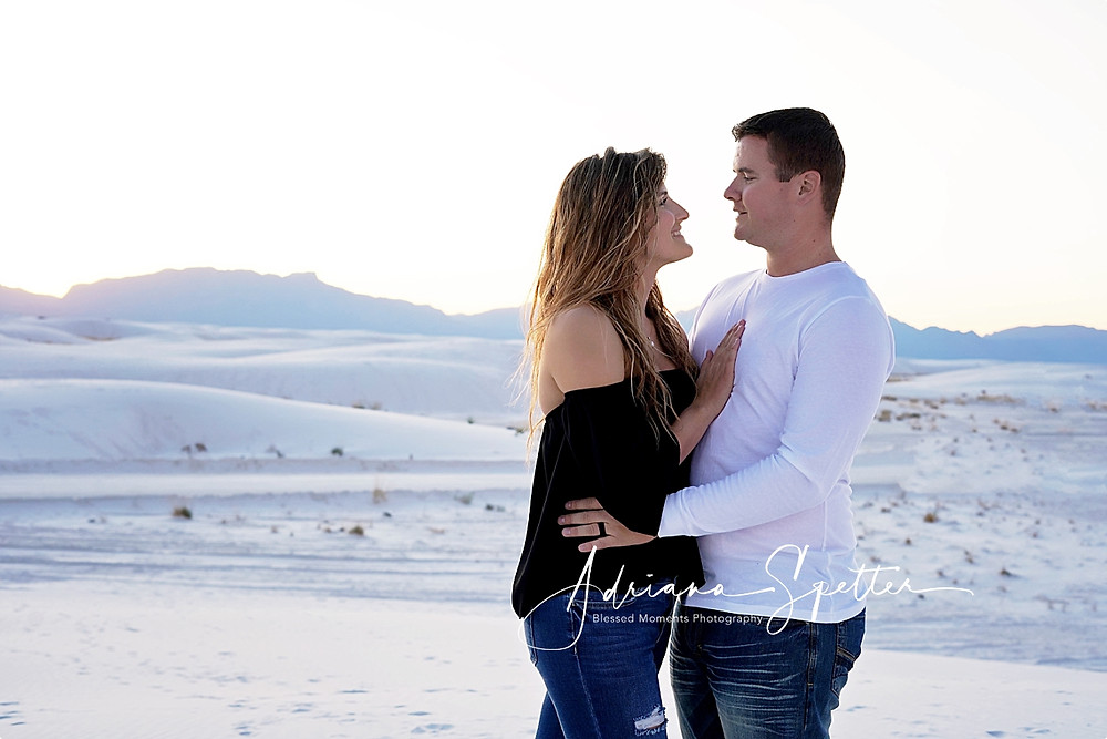 Couple looking into each other eyes at White Sands National Monument