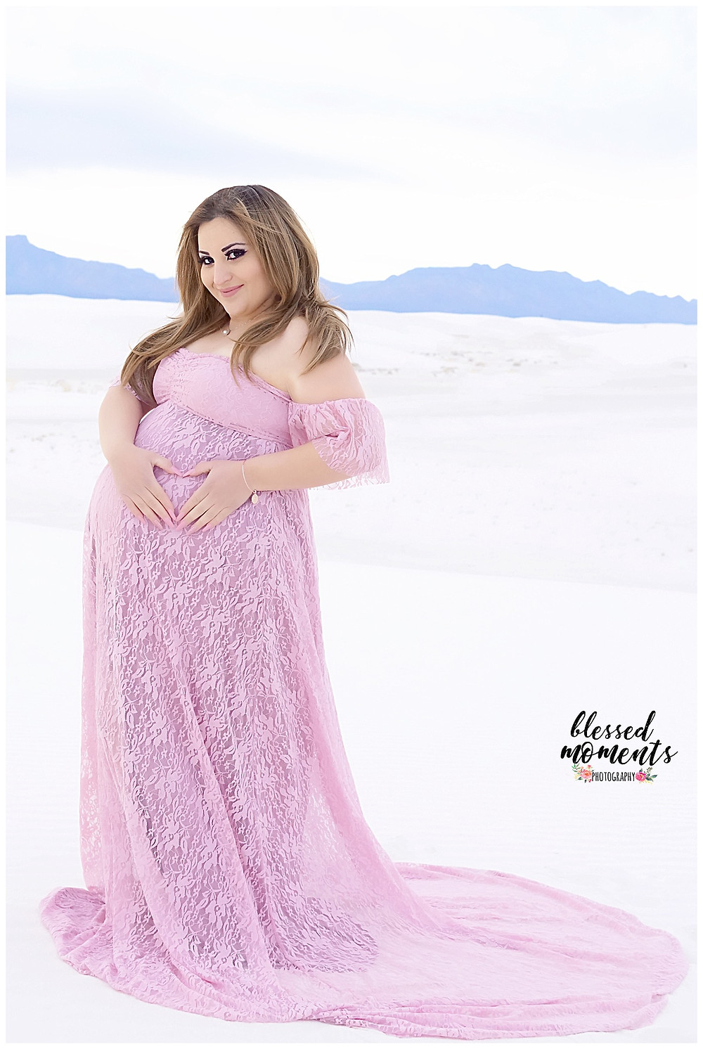 Maternity photography of El Paso woman taken at White Sands National Monument wearing a Pink Lace gown