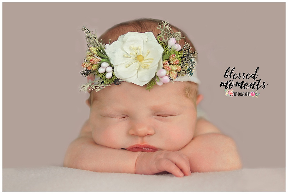 Newborn photo of baby girl with floral headband