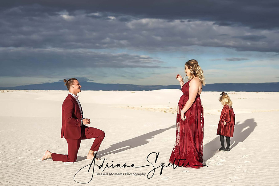 White Sands proposal photography with man proposing and woman crying with happiness
