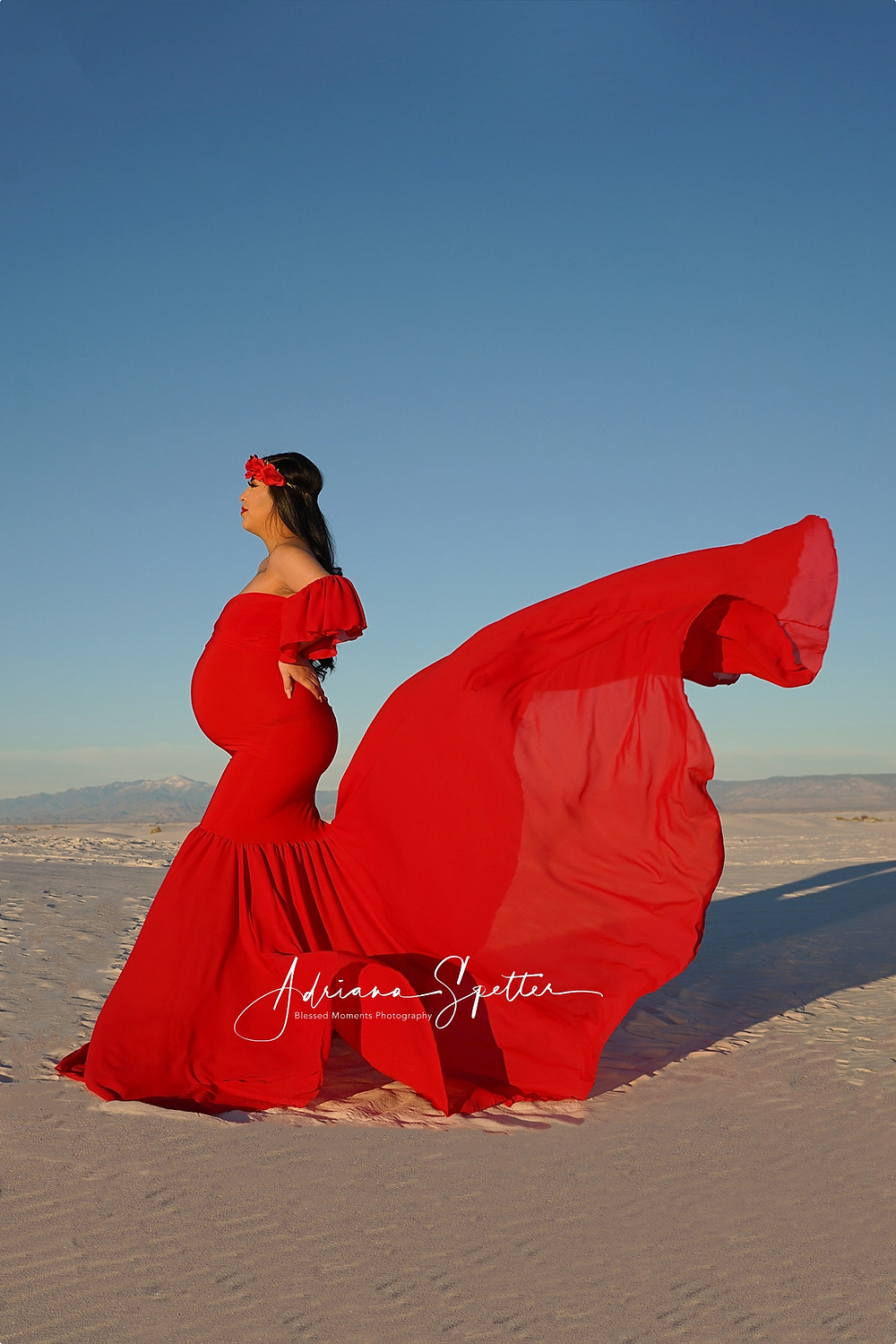 Red dress flowing at White Sands National Park.