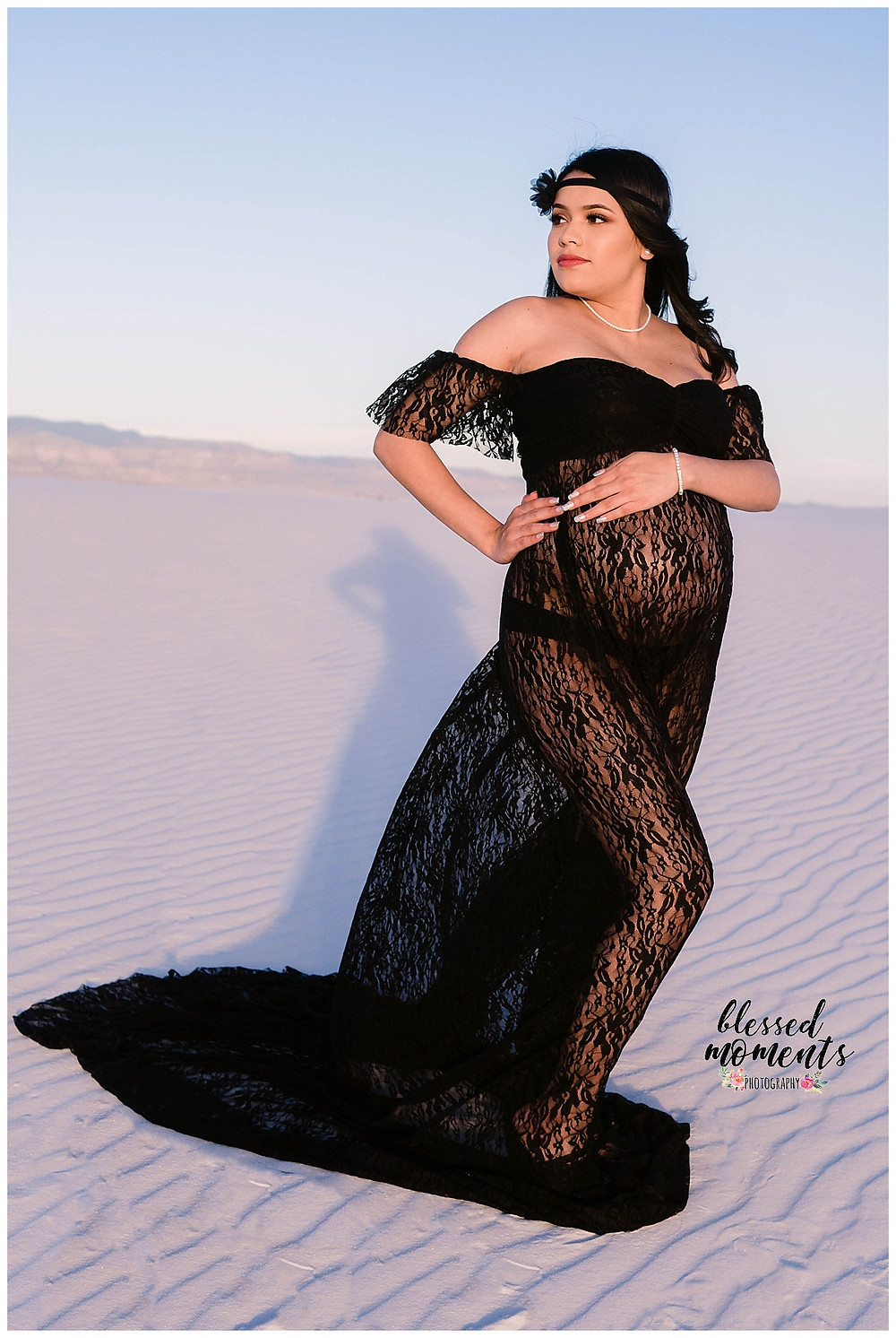 El Paso mama wearing a black lace maternity gown in White Sands National Monument