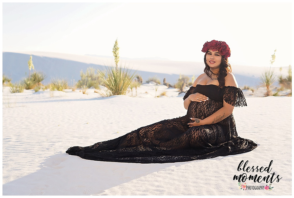Pregnant mama wearing a Black lace Maternity gown at White Sands National Monument