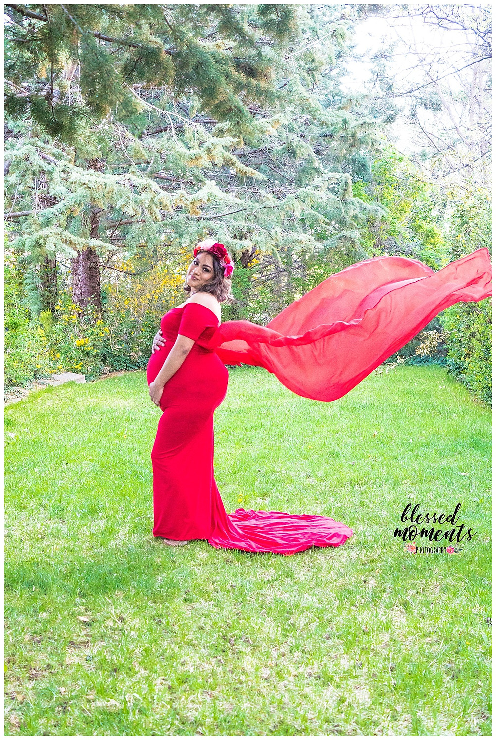 Maternity session taken at State Capital in Santa Fe NM with mama wearing a red mermaid gown.