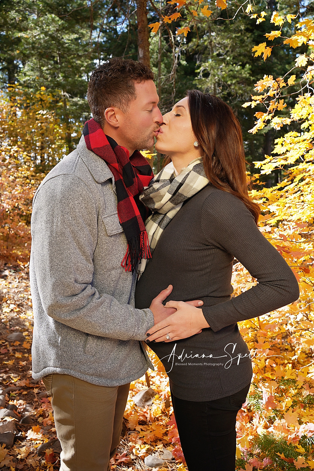 Couple kissing in maternity photo session in the fall at Cloudcroft.