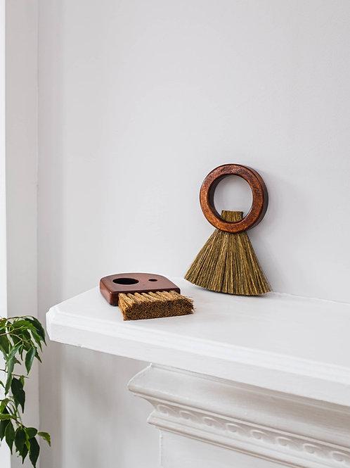 Hoop Broom on fireplace