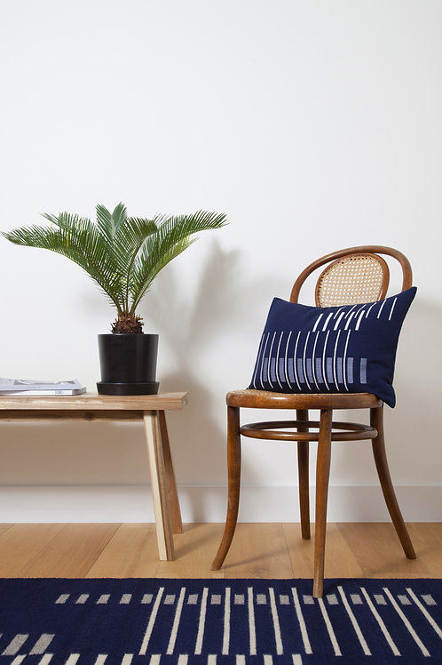 Handmade Parallel Cushion Navy on a Chair