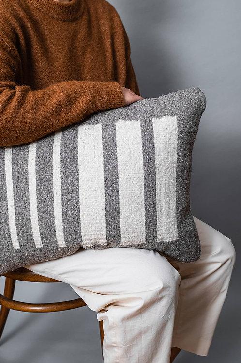Handmade Pilotis Cushion Grey held under arm