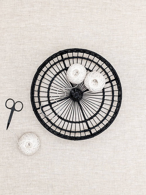 Black Tangent Tray on table with string and scissors
