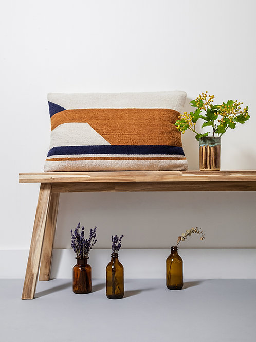 Large Convergent Cushion on a wooden bench next to flowers