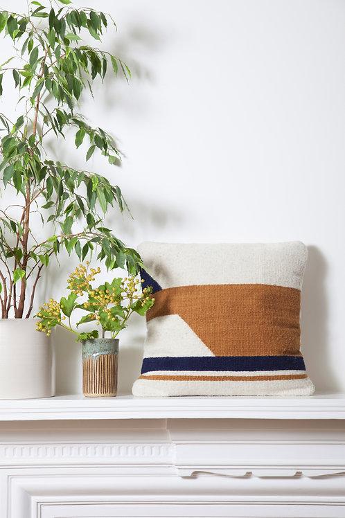 Handmade Small Convergent Cushion Mostaza next to Plants