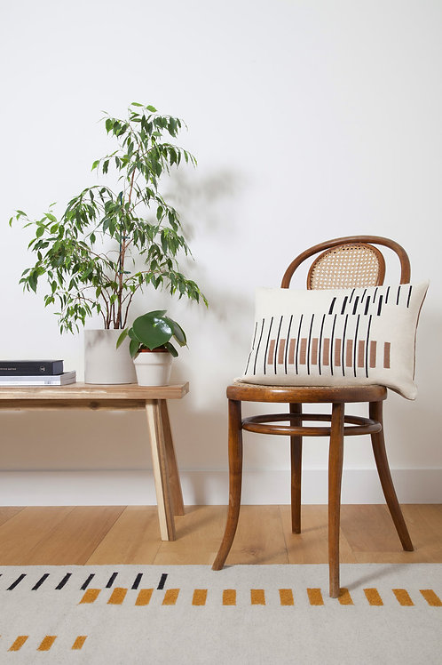 decorative Parallel Cushion Off White on Thonet chair next to bench with plants