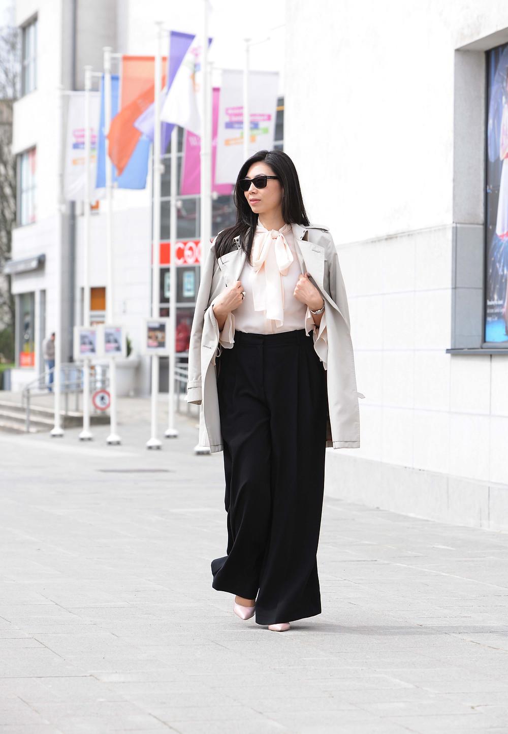Blush blouse with white pants.