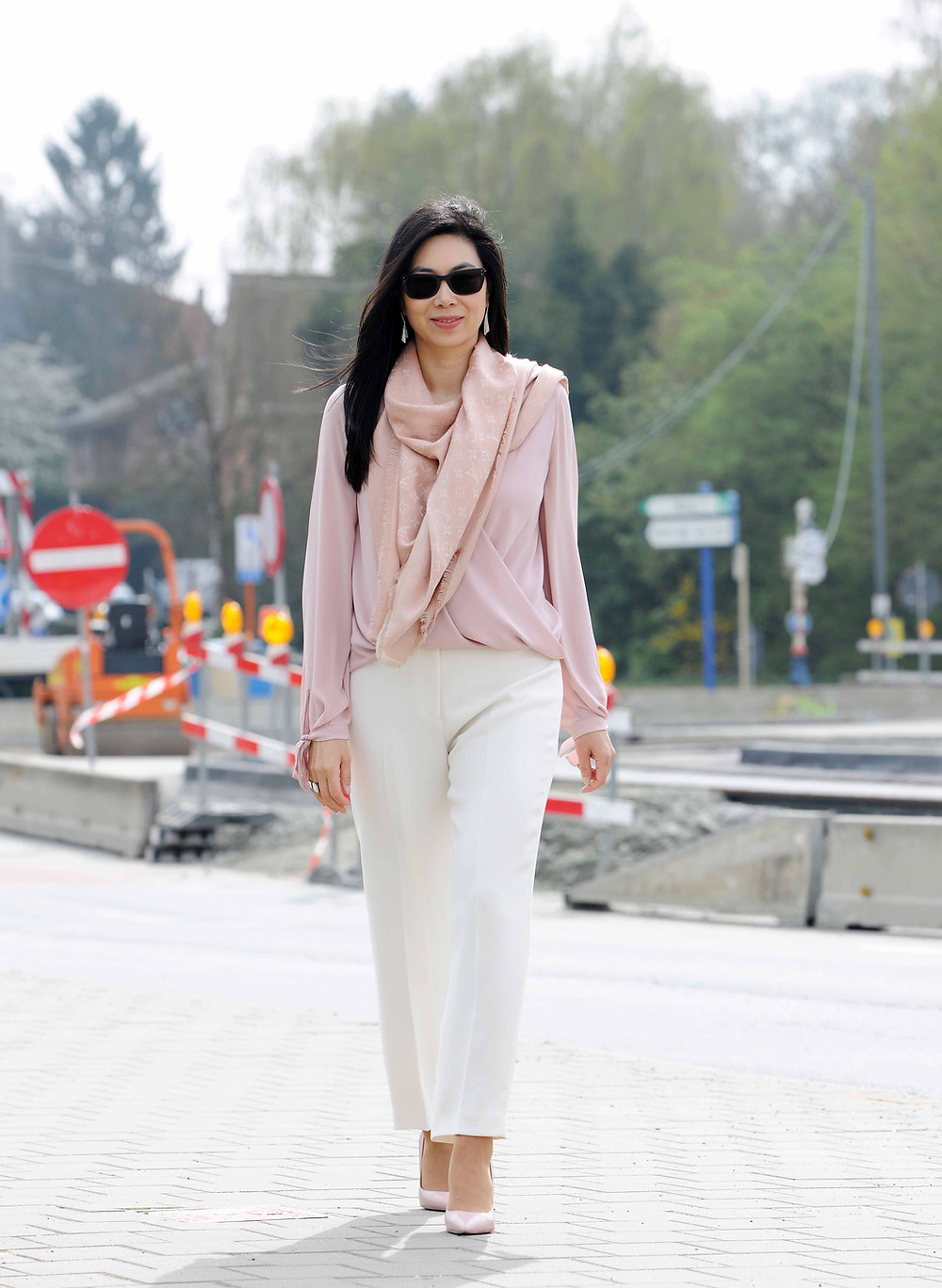 White classic straight pants and blush blouse for an office appropiate look.