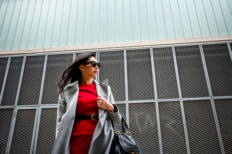 Woman wearing a red pencil dress from Rolan Mouret with a light grey wool coat